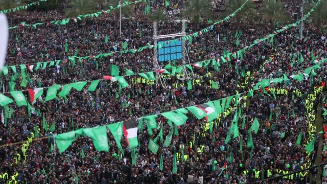 palestinian hamas supporters attend a rally marking the 30th anniversary of the founding of the hamas movement 30th anniversary of the founding of... - hamas stock videos & royalty-free footage