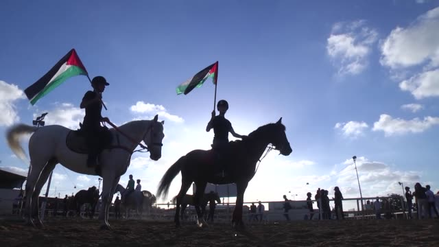 palestinian kids attend an equestrian championship for children organized by al jawad equestrian club to show solidarity with hungerstriker prisoners... - prisoner icon stock videos & royalty-free footage