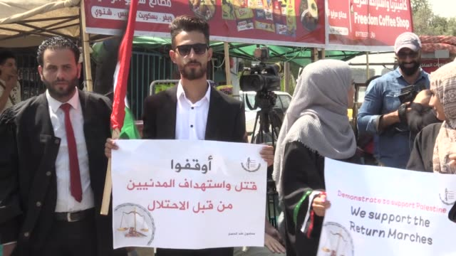 palestinian lawyers stage a rally in the gaza strip on august 20 2019 to protest israel's 12year blockade on the seaside territory faten lulu a... - legal occupation stock videos and b-roll footage