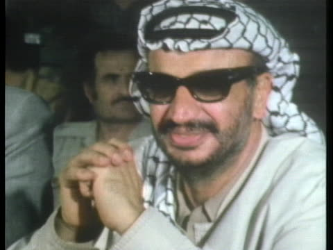palestinian leader yasser arafat attends a meeting of the palestinian national council in cairo. - palestine liberation organisation stock videos & royalty-free footage