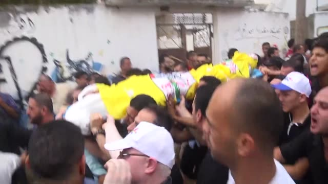 palestinian mourners and relatives carry the body of 15-year-old palestinian osman rami hills, was killed by israeli live bullet during friday's... - friday stock videos & royalty-free footage