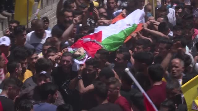 palestinian mourners burry sixteen-year-old said youssef muhammad oudeh in the occupied west bank city of nablus, after he was shot dead by the... - dead stock videos & royalty-free footage