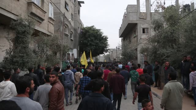 Palestinian mourners carry the body of Zakaria alKafarneh who was killed during clashes with Israeli troops during his funeral in Beit Hanoun in the...