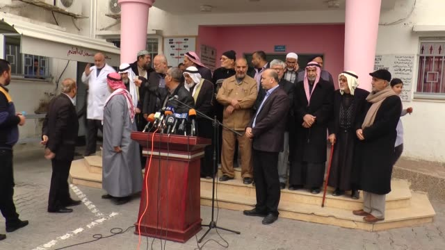 stockvideo's en b-roll-footage met palestinian muslim scholars stage a rally in the gaza strip on february 11, 2018 to protest an acute power crisis taking a heavy toll on hospitals in... - plant stage