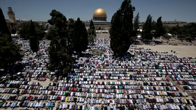 palestinian muslim worshipers prayed outside dome of the rock at the alaqsa mosque compound in jerusalem during the first friday prayer of the holy... - compounding stock videos and b-roll footage