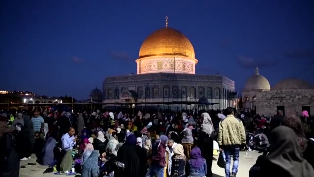 Palestinian Muslim worshippers pray on Wednesday night outside the Dome of the Rock in the Al Aqsa mosques compound in Jerusalem's Old City on the...
