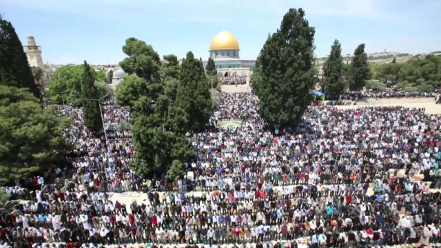 palestinian muslims from across the israelioccupied west bank flock to east jerusalem's alaqsa mosque to mark the first friday of the ramadan fasting... - al aqsa mosque stock videos and b-roll footage