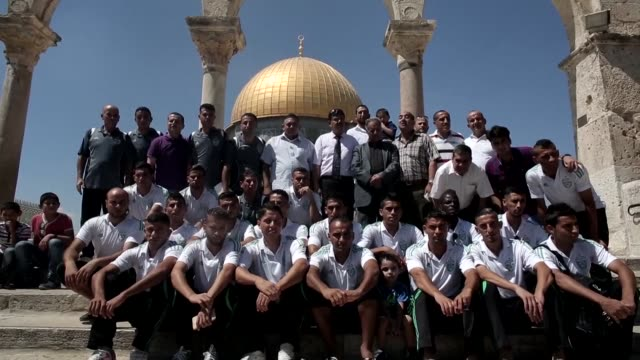 palestinian players from gaza city's shejaiya football club visited on wednesday jerusalem's alaqsa mosque compound islam's third holiest site after... - compounding stock videos and b-roll footage