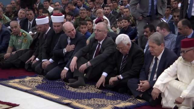 palestinian president mahmoud abbas and palestinian prime minister rami hamdallah performs eid elfitr prayer in ramallah city of west bank on july 06... - prime minister stock videos & royalty-free footage
