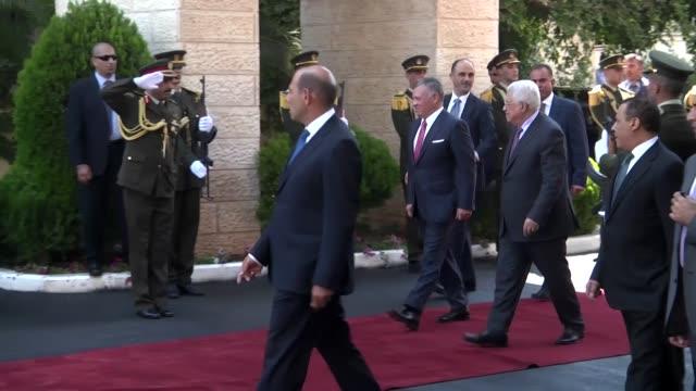 Palestinian President Mahmoud Abbas bids farewell to King Abdullah II of Jordan after their meeting in West Bank city of Ramallah on August 07 2017...