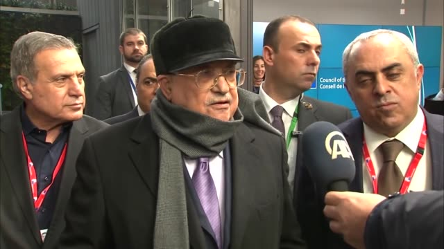 Palestinian President Mahmoud Abbas speaks to reporters as he leaves the European Council headquarters following a meeting with EU High...