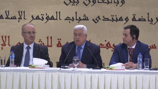 Palestinian President Mahmud Abbas and Turkish Minister of Youth and Sports Osman Askin Bak attend the 'Jerusalem Conference as the Capital of the...