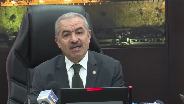 palestinian prime minister mohammad shtayyeh condemns the israeli airstrikes on the gaza strip during a government meeting held in ramallah asking... - ramallah stock videos and b-roll footage