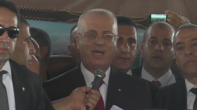 palestinian prime minister rami hamdallah holds a press conference upon his arrival to the palestinian side of the beit hanoun border crossing in... - hamas stock videos & royalty-free footage