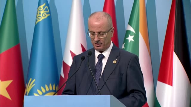 Palestinian Prime Minister Rami Hamdallah speaks during a joint press conference with OIC Secretary General Yousef bin Ahmed AlOthaimeen and Turkish...