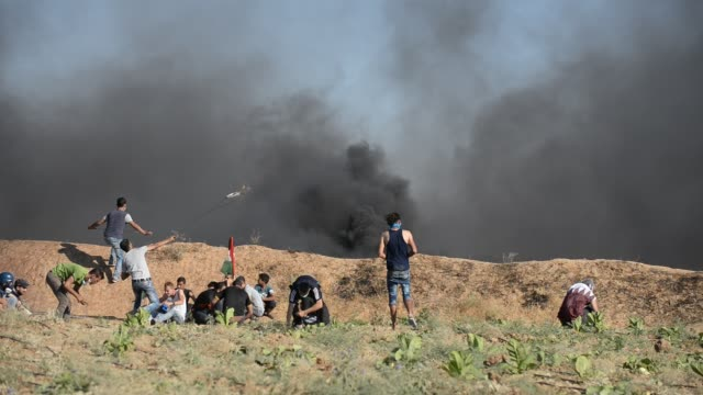 a palestinian protester with a slingshot clashes with the israeli security forces during a protest against the israeli blockade at israeli border in... - catapult stock videos & royalty-free footage
