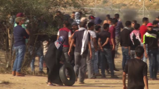 palestinian protesters clash with israeli forces along the border with the gaza strip east of khan yunis on may 18 2018 yahya sinwar leader of hamas... - 2018 gaza border protests stock videos & royalty-free footage