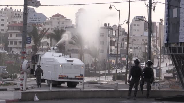 palestinian protesters clash with israeli forces during a demonstration near the albireh town of ramallah west bank on february 09 2018 21... - ramallah stock videos and b-roll footage