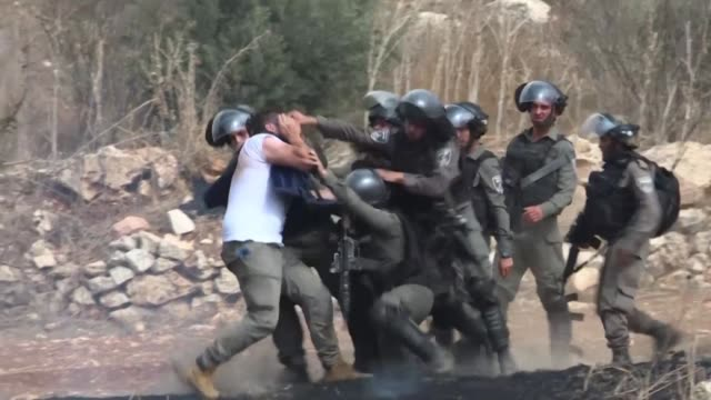 palestinian protesters clash with israeli security forces as they demonstrate near the palestinian village of turmus ayya against the israeli... - palestinian stock videos & royalty-free footage
