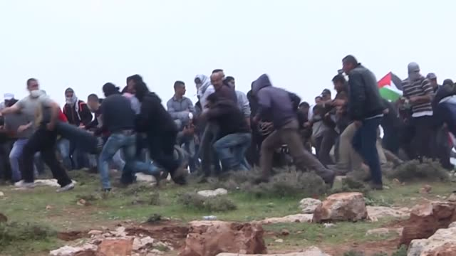 palestinian protesters clash with israeli security forces during a protest against prefabricated houses that are build in kafr kaddum and almughayir... - ramallah stock videos and b-roll footage
