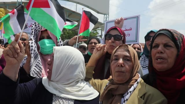 palestinian protesters , some mask-clad due to the covid-19 coronavirus pandemic, march waves national flags and hold posters of palestinian... - micro organism stock videos & royalty-free footage
