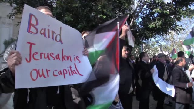 Palestinian protesters wave national flags and shout slogans outside the Foreign Affairs ministry where Palestinian Minister of Foreign Affairs Riyad...
