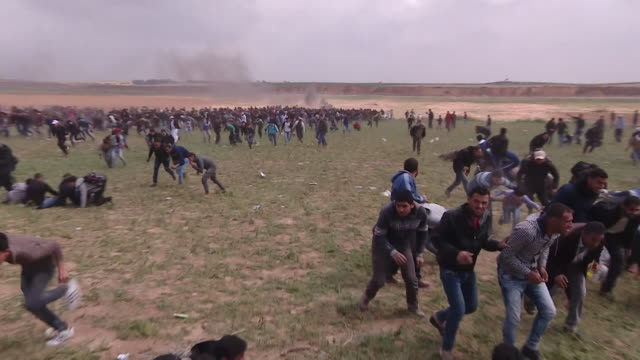 Palestinian protestors clashing with Israeli Defense Forces on the GazaIsrael border