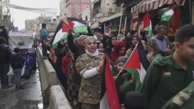 palestinian refugees take to the streets in the shatila refugee camp in lebanon's capital beirut to protest a day after us president donald trump... - palestinian stock videos & royalty-free footage
