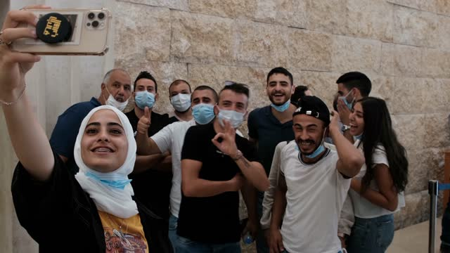 palestinian residents of sheikh jarrah take a selfie before attending a petition regarding evacuation from their home in sheikh jarrah neighborhood,... - courthouse stock videos & royalty-free footage