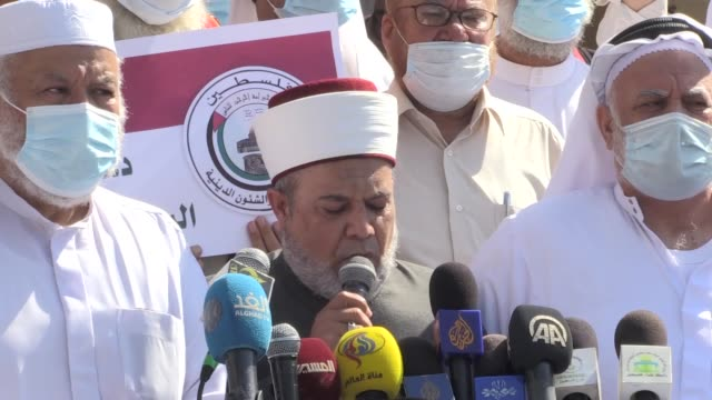 palestinian scholars on monday staged a protest in gaza against french insults of islam. the demonstration was organized by the association of... - satire stock videos & royalty-free footage