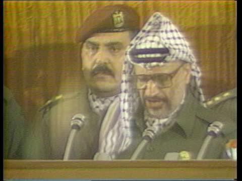 Algiers CMS Yasser Arafat speaking at podium animatedly as announces Palestine statehood applause heard SOF TGV Meeting of Palestine National Council...