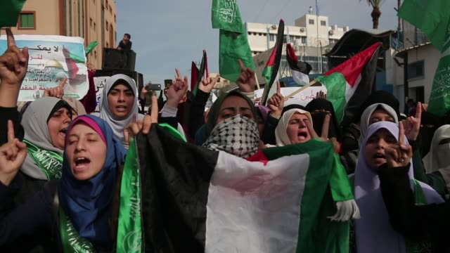 palestinian students take part in a protest against us president donald trump's decision to recognise jerusalem as the capital of israel in gaza city... - embassy stock videos and b-roll footage