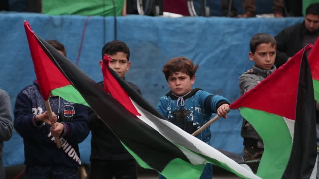 palestinian supporters hamas movement take part during a protest against us president donald trump's decision to recognise jerusalem as the capital... - embassy stock videos and b-roll footage