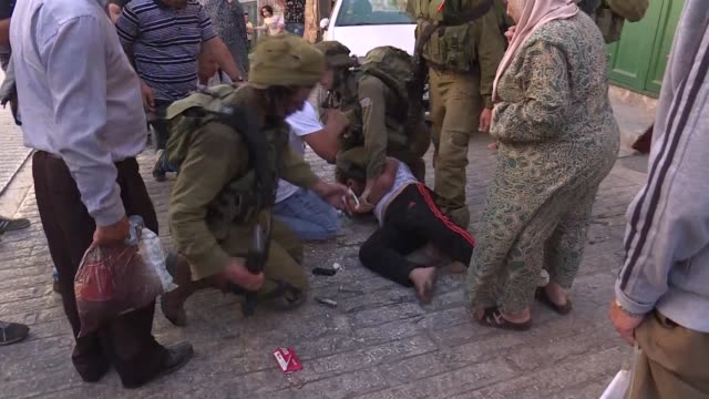 A Palestinian teenager tried to stab an Israeli soldier near the flashpoint West Bank city of Hebron on Tuesday before being shot dead officials said...