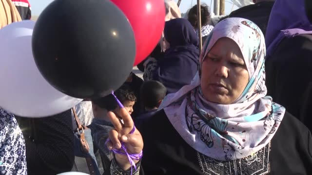 palestinian women hold balloons during a demonstration to support the 'great march of return' organized by palestinians in gaza city gaza on april 10... - middle east stock videos & royalty-free footage