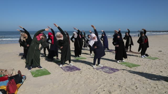 palestinian women practise yoga on the beach in gaza city on march 3, 2020 during an event organised by the the positive energy club. - gaza city stock videos & royalty-free footage