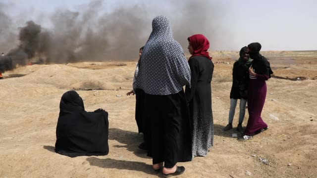 palestinian women sit near the border fence with israel as mass demonstrations at the fence continue on may 11 2018 in gaza city gaza one man was... - 2018 gaza border protests stock videos & royalty-free footage