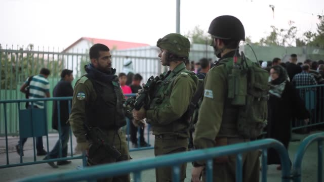 palestinian worshippers mostly from women move for passing through the qalandiya checkpoint from ramallah into jerusalem after israeli authorities... - west bank stock videos & royalty-free footage