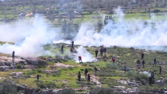 palestinian youths clash with israeli forces in a village south of nablus in the occupied west bank - west bank stock videos & royalty-free footage