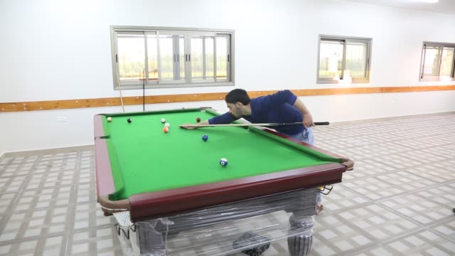 palestinian youths play billiards in a newly opened pool hall in gaza strip on march 3 2019 pool halls and other games have begun to reemerge - pool hall stock videos and b-roll footage