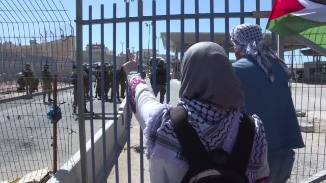 palestinians among whom a majority of women marched in front of qalandiya checkpoint wednesday on the eve of the international day for women's rights - israel stock videos & royalty-free footage