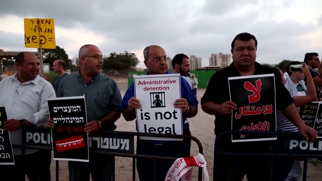 palestinians and arab israelis protested on tuesday outside the ashkelon hospital in israel against administrative detention and in support of... - ashkelon stock videos and b-roll footage