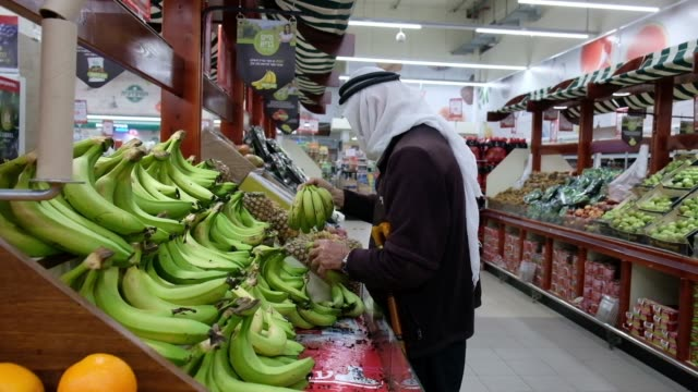 palestinians and israeli customers buying products in rami levy supermarket which is part of an israeli discount supermarket chain that operates... - eddie gerald stock videos & royalty-free footage