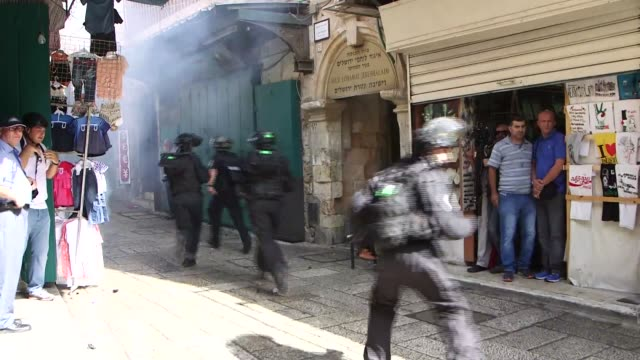 palestinians and israeli security forces clashed in jerusalems flashpoint al aqsa mosque compound and the surrounding old city for a third straight... - surrounding stock videos & royalty-free footage