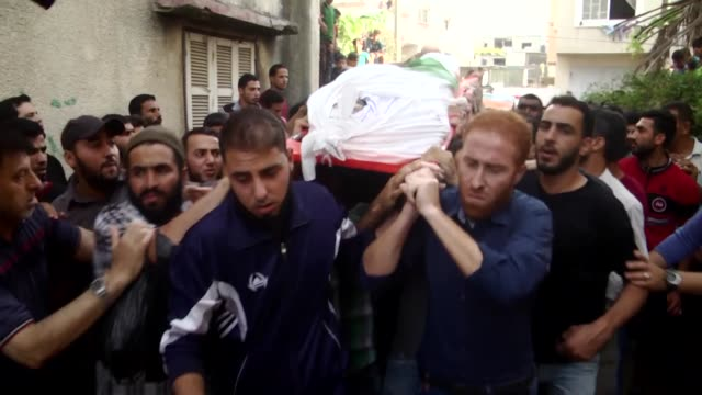 Palestinians atten funeral of Mohamed Ahmed alRadei who was killed in an Israeli shelling near the Gaza Strip's northern border on May 28 2018 in...