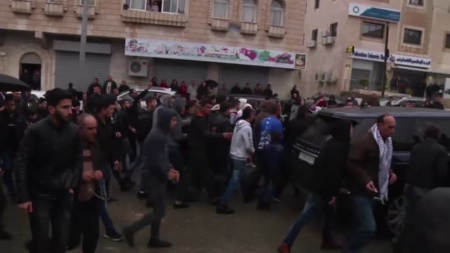 palestinians attend funeral ceremony of 22yearold ilyas yasin who was killed by israeli forces after allegedly attempting knife attack on october 15... - パレスチナ文化点の映像素材/bロール
