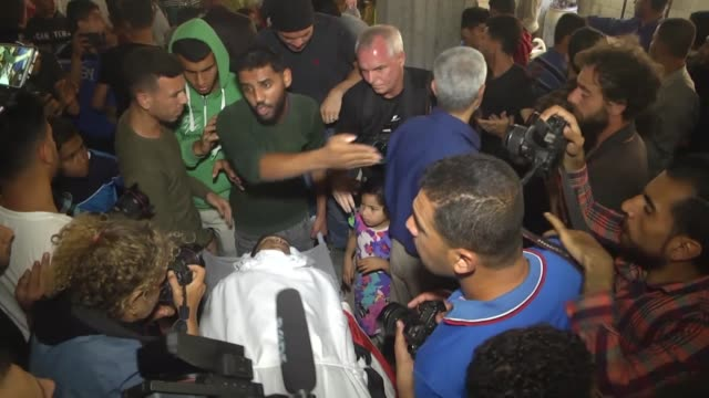 palestinians attend funeral of 15-year-old jamal abdul rahman afana in rafah, gaza strip on may 12, 2018. palestinian teenager on saturday succumbed... - 70周年点の映像素材/bロール