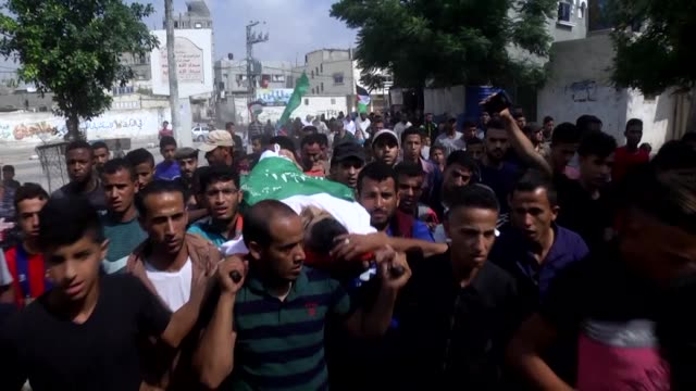 Palestinians attend the funeral of 17yearold Ashraf Abu Azzoum in Rafah southern Gaza Strip on June 28 2018 The Palestinian youth has died of...