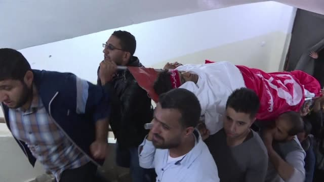 Palestinians attend the funeral of Mohammed Ouda 22 in Beit Lahia who was killed the previous day in an Israeli strike