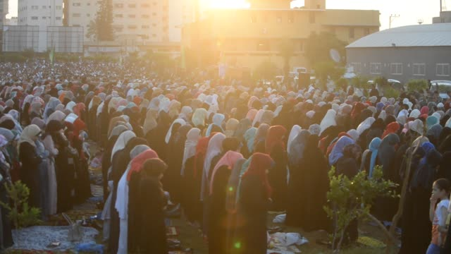 palestinians attend the morning prayers for eid alfitr celebrations which marks the end of the holy fasting month of ramadan in gaza city on june 25... - eid mubarak stock videos & royalty-free footage